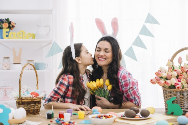 daughter-kissing-her-mother-easter-day-celebration